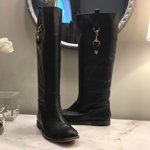 Coach tall black boot with gold clip embellishment